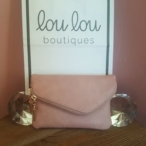 Pink faux leather clutch/crossbody bag